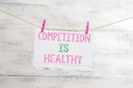 Writing note showing Competition Is Healthy. Business concept for Rivalry is good in any Venture leads to Improvement Clothesline clothespin rectangle shaped paper reminder white wood desk Banco de Imagens