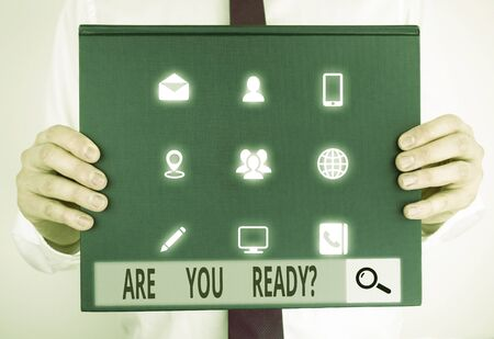 Text sign showing Are You Ready Question. Business photo text Setting oneself on the activity Being Prepared Male human holding thick textured cardboard of business promotion concept