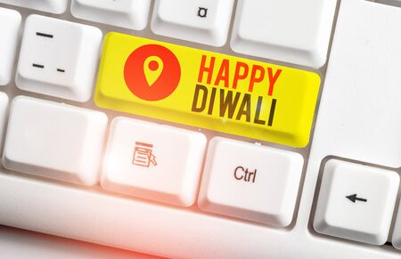 Text sign showing Happy Diwali. Business photo showcasing festival of lights that celebrated by millions of Hindus White pc keyboard with empty note paper above white background key copy space