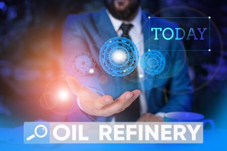 Word writing text Oil Refinery. Business photo showcasing industrial process of converting crude oil into petroleum Male human wear formal work suit presenting presentation using smart device