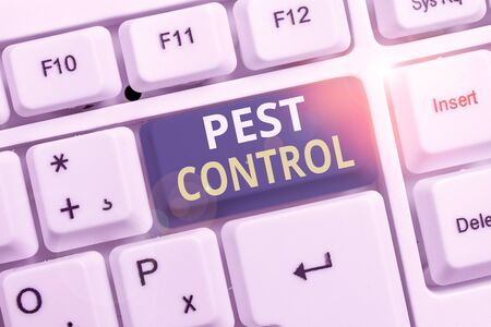 Conceptual hand writing showing Pest Control. Concept meaning analysisagement of a species that impacts adversely on huanalysis White pc keyboard with note paper above the white background 写真素材
