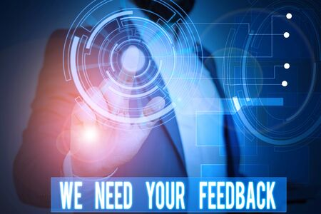 Handwriting text writing We Need Your Feedback. Conceptual photo Give us your review thoughts comments what to improve Male human wear formal work suit presenting presentation using smart device