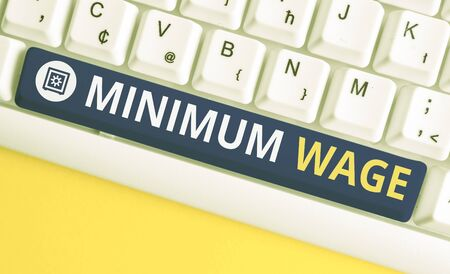 Handwriting text Minimum Wage. Conceptual photo the lowest wage permitted by law or by a special agreement White pc keyboard with empty note paper above white background key copy space