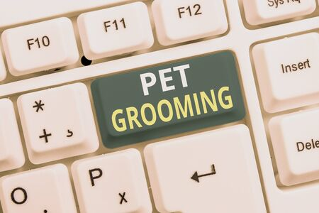 Conceptual hand writing showing Pet Grooming. Concept meaning hygienic care and enhancing the appearance of the pets White pc keyboard with note paper above the white background