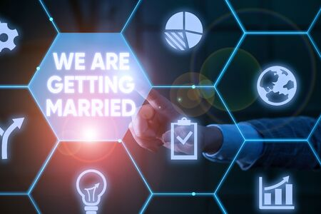 Writing note showing We Are Getting Married. Business concept for Engagement Wedding preparation Loving couple Male human wear formal suit presenting using smart device