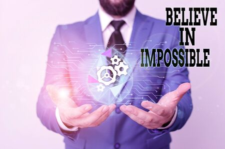 Writing note showing Believe In Impossible. Business concept for You can do it everything is possible Work hard Male human wear formal suit presenting using smart device 스톡 콘텐츠
