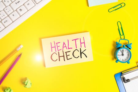 Handwriting text Health Check. Conceptual photo thorough physical examination A medical checkup of oneself Flat lay above copy space on the white crumpled paper Stockfoto