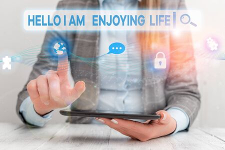 Text sign showing Hello I Am Enjoying Life. Business photo showcasing Happy relaxed lifestyle Enjoy simple things Female human wear formal work suit presenting presentation use smart device
