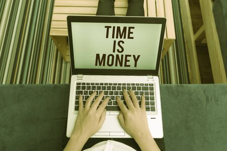 Writing note showing Time Is Money. Business concept for time is a valuable resource Do things as quickly as possible woman laptop computer office supplies technological devices inside home