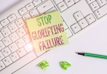Writing note showing Stop Glorifying Failure. Business concept for do not let Breakdown Rule your life Try again Green note paper with pencil on white background and pc keyboard Stockfoto