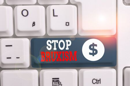 Writing note showing Stop Bruxism. Business concept for put an end to a condition which you grind or clench the teeth White pc keyboard with note paper above the white background
