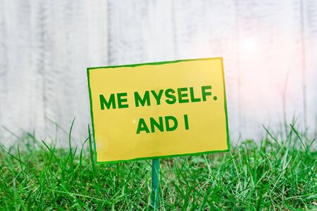 Handwriting text writing Me Myself And I. Conceptual photo used by speaker to refer to herself as the object of a verb Plain empty paper attached to a stick and placed in the green grassy land