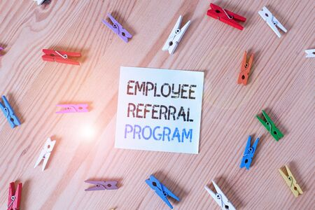 Writing note showing Employee Referral Program. Business concept for employees recommend qualified friends relatives Colored clothespin papers empty reminder wooden floor background office