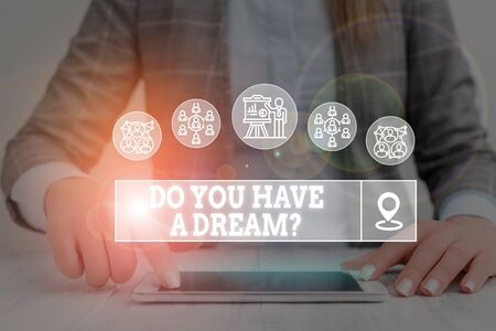 Word writing text Do You Have A Dream Question. Business photo showcasing asking someone about life goals Achievements Woman wear formal work suit presenting presentation using smart device