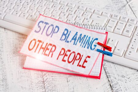 Word writing text Stop Blaming Other People. Business photo showcasing Do not make excuses assume your faults guilt notebook paper reminder clothespin pinned sheet white keyboard light wooden