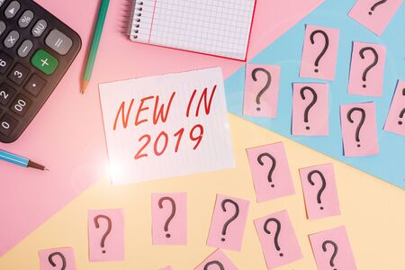 Word writing text New In 2019. Business photo showcasing what will be expecting or new creation for the year 2019 Mathematics stuff and writing equipment above pastel colours background 版權商用圖片