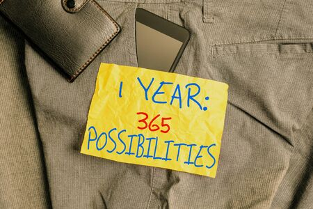 Writing note showing 1 Year 365 Possibilities. Business concept for Beginning of a New Day Lots of Chances to Start Smartphone device inside trousers front pocket with wallet