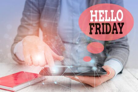 Text sign showing Hello Friday. Business photo text Greetings on Fridays because it is the end of the work week Female human wear formal work suit presenting presentation use smart device Archivio Fotografico