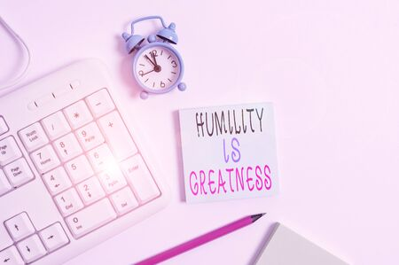 Conceptual hand writing showing Humility Is Greatness. Concept meaning being Humble is a Virtue not to Feel overly Superior Keyboard with empty note paper and pencil white background