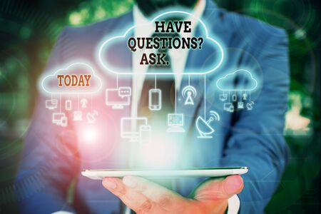 Text sign showing Have Questions Question Ask. Business photo text asking someone respond you with feedback Male human wear formal work suit presenting presentation using smart device
