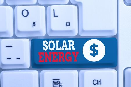 Writing note showing Solar Energy. Business concept for radiation from the Sun capable of producing heat or electricity White pc keyboard with note paper above the white background