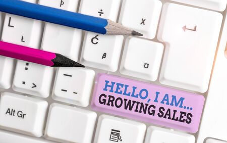 Handwriting text Hello I Am Growing Sales. Conceptual photo Making more money Selling larger quantities White pc keyboard with empty note paper above white background key copy space