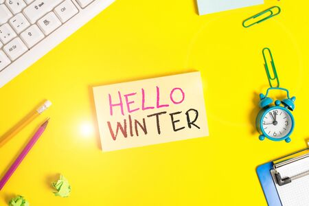 Handwriting text Hello Winter. Conceptual photo coldest season of the year in polar and temperate zones Flat lay above copy space on the white crumpled paper