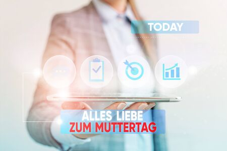 Conceptual hand writing showing Alles Liebe Zum Muttertag. Concept meaning Happy Mothers Day Love Good wishes Affection Female human wear formal work suit presenting smart device
