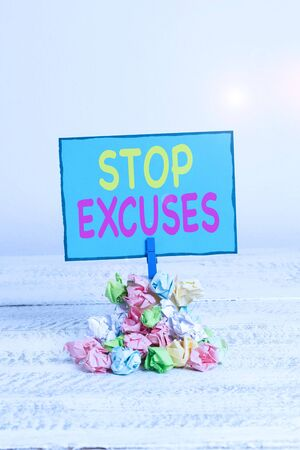 Text sign showing Stop Excuses. Business photo showcasing put an end to an explanation for something that went wrong Reminder pile colored crumpled paper clothespin reminder white wooden space Stock fotó