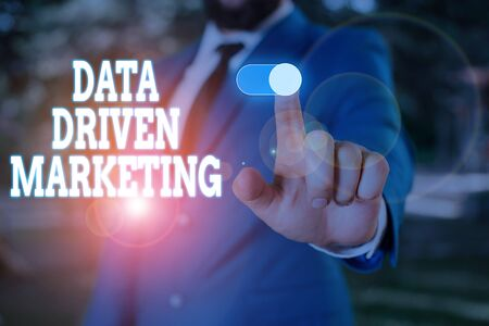 Text sign showing Data Driven Marketing. Business photo text Strategy built on Insights Analysis from interactions Male human wear formal work suit presenting presentation using smart device