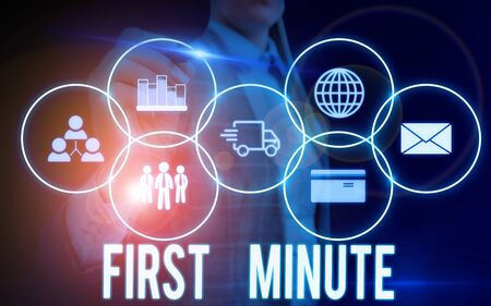 Writing note showing First Minute. Business concept for promotional offers last within a very short amount of time Woman wear formal work suit presenting presentation using smart device