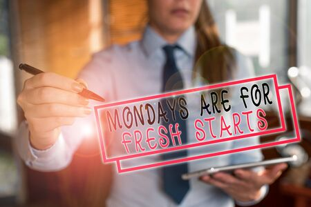 Text sign showing Mondays Are For Fresh Starts. Business photo text Begin again every week have a good morning Blurred woman in the background pointing with finger in empty space Archivio Fotografico - 131449950