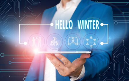 Text sign showing Hello Winter. Business photo text coldest season of the year in polar and temperate zones Male human wear formal work suit presenting presentation using smart device