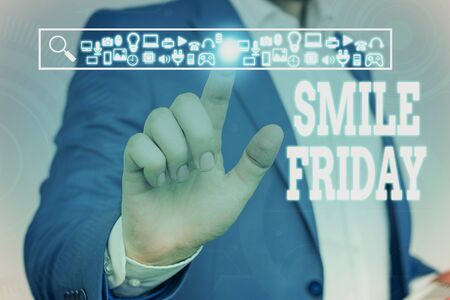 Handwriting text Smile Friday. Conceptual photo used to express happiness from beginning of fresh week Male human wear formal work suit presenting presentation using smart device Archivio Fotografico - 131450215