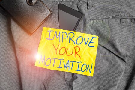 Writing note showing Improve Your Motivation. Business concept for Boost your self drive Enhance Motives and Goals Smartphone device inside trousers front pocket with wallet