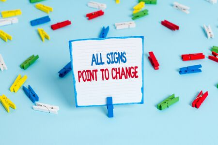 Conceptual hand writing showing All Signs Point To Change. Concept meaning Necessity of doing things differently new vision Colored clothespin papers empty reminder blue floor officepin