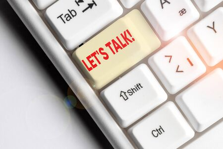 Conceptual hand writing showing Let S Talk. Concept meaning they are suggesting beginning conversation on specific topic White pc keyboard with note paper above the white background Stock fotó