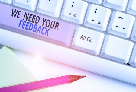 Text sign showing We Need Your Feedback. Business photo showcasing Give us your review thoughts comments what to improve White pc keyboard with empty note paper above white background key copy space