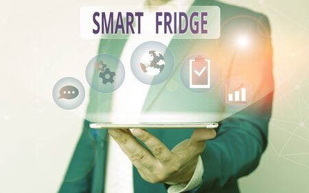 Handwriting text writing Smart Fridge. Conceptual photo programmed to sense what kinds of products being stored inside Male human wear formal work suit presenting presentation using smart device Zdjęcie Seryjne