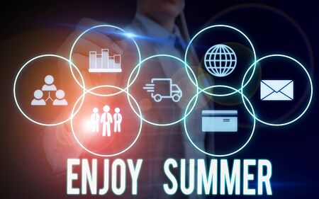 Writing note showing Enjoy Summer. Business concept for taking a break from school and spending holidays in the beach Woman wear formal work suit presenting presentation using smart device