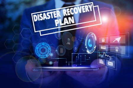 Conceptual hand writing showing Disaster Recovery Plan. Concept meaning having backup measures against dangerous situation Male wear formal suit presenting presentation smart device