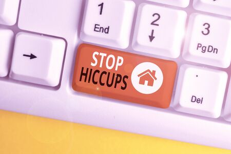 Conceptual hand writing showing Stop Hiccups. Concept meaning get rid of the involuntary spasm of the diaphragm muscles White pc keyboard with note paper above the white background