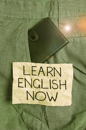 Word writing text Learn English Now. Business photo showcasing gain or acquire knowledge and skill of english language Small little wallet inside man trousers front pocket near notation paper