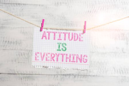 Writing note showing Attitude Is Everything. Business concept for Positive Outlook is the Guide to a Good Life Clothesline clothespin rectangle shaped paper reminder white wood desk