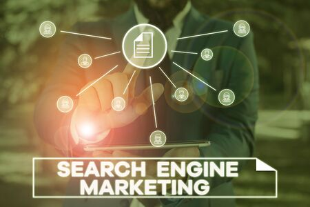 Handwriting text writing Search Engine Marketing. Conceptual photo promote Website visibility on searched result pages Male human wear formal work suit presenting presentation using smart device