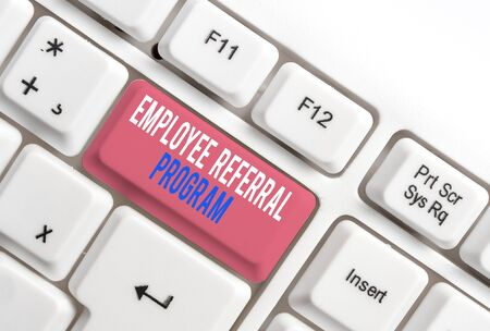Text sign showing Employee Referral Program. Business photo showcasing employees recommend qualified friends relatives White pc keyboard with empty note paper above white background key copy space 版權商用圖片