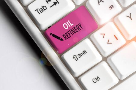 Handwriting text Oil Refinery. Conceptual photo industrial process of converting crude oil into petroleum White pc keyboard with empty note paper above white background key copy space