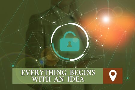 Word writing text Everything Begins With An Idea. Business photo showcasing steps you take to turn an idea into a reality Woman wear formal work suit presenting presentation using smart device Stockfoto