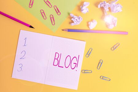 Word writing text Blog. Business photo showcasing regularly updated website or web page run by an individual or group Blank squared notebook pencils paper sheet crushed balls colored background