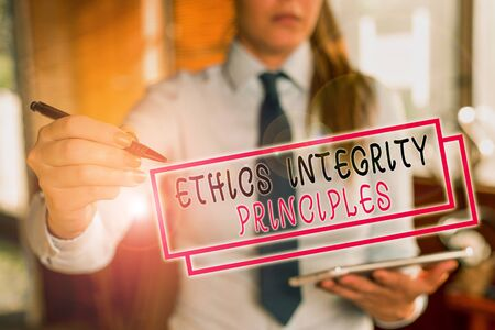 Text sign showing Ethics Integrity Principles. Business photo text quality of being honest and having strong moral Blurred woman in the background pointing with finger in empty space